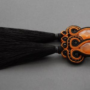 czarno-pomarańczowe kolczyki lub klipsy sutasz
