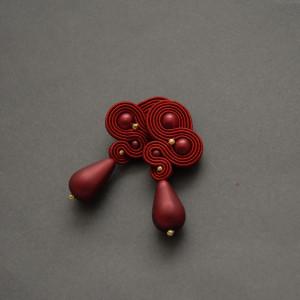 czerwone kolczyki lub klipsy sutasz 1