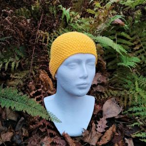 Energetyczna żółto pomarańczowa opaska na głowę.