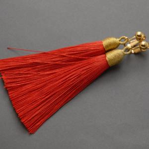 kolczyki lub klipsy z chwostami (czerwone)