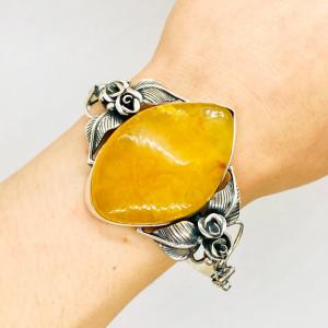Srebrna damska bransoleta z bursztynem bałtyckim
