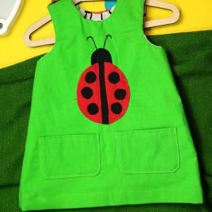 Zielona sukienka dwustronna z biedronką (80 cm)